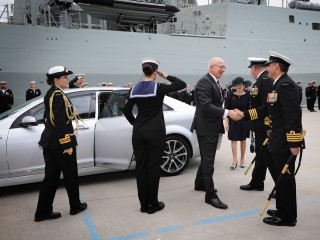 His Excellency General The Honourable David Hurley AC DSC Retd Governor of NSW and Mrs Linda Hurley were greeted by Rear Admiral Stuart Mayer and Captain John Stavridis RAN at HMAS Hobart Commissioning at Garden Island